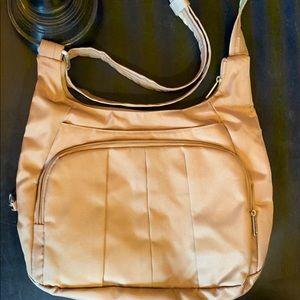 like new. travelon. purse.